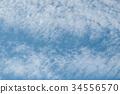 closeup of contrail in a blue sky 34556570