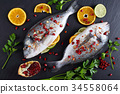 fish marinated with lemon and spices 34558064