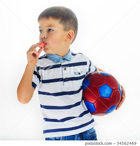 little boy footballer isolated 34562469