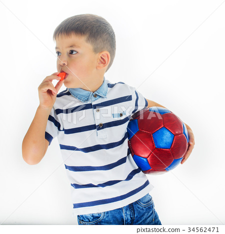 little boy footballer isolated 34562471