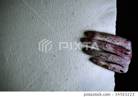 scary and bloody hand holding a blank paper 34563223