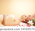 Young woman relaxing on a spa massage 34569574