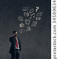 Conceptual image of a young businessman 34569634
