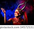 Mad satan woman on black magic ritual of in hell. 34572531