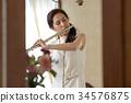 吹長笛的婦女 34576875