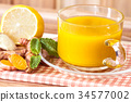 a cup of Turmeric Tea with lemon and ginger 34577002