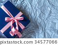 Dark blue gift box with  ribbon decoration 34577066