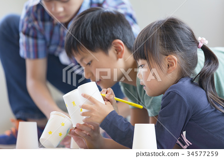 Elementary school student drawing work seriously 34577259
