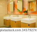 Interior of bathroom with sink basin faucet. 34579274