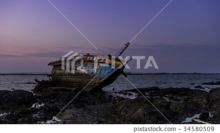 Abandoned shipwreck in sunset 34580509