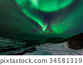 Northern lights above the fjord in Norway 34581319