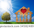 Wooden House with Family on Green Grass 34582489
