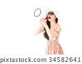 beautiful lady holding loudspeaker telling news 34582641