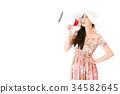 attractive elegant dress woman holding loudspeaker 34582645