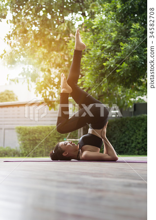 Attractive woman Playing yoga For her good health 34582708