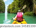 Woman on kayak in calm tropical lagoon Koh Hong 34585399