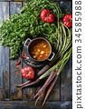 Carrot tomato pea soup 34585988