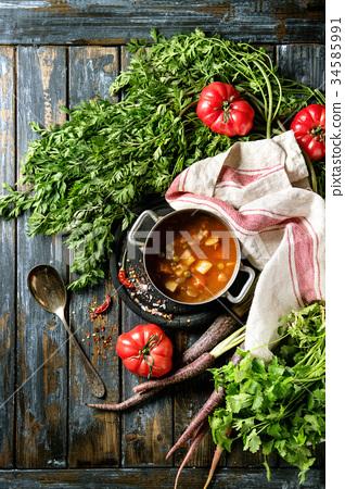 Carrot tomato pea soup 34585991