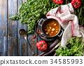 Carrot tomato pea soup 34585993