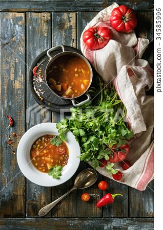 Carrot tomato pea soup 34585996