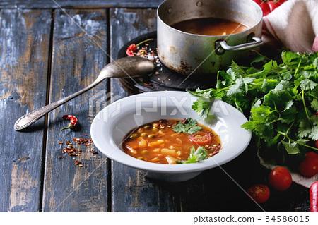 Carrot tomato pea soup 34586015