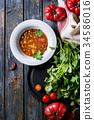 Carrot tomato pea soup 34586016