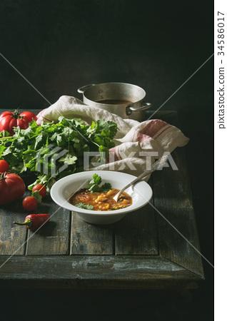 Carrot tomato pea soup 34586017