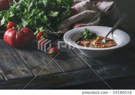 Carrot tomato pea soup 34586018