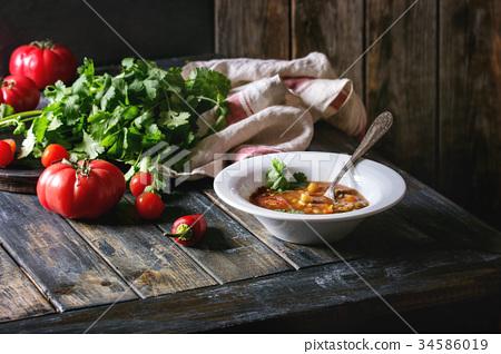 Carrot tomato pea soup 34586019