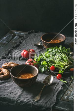 Carrot tomato pea soup 34586020