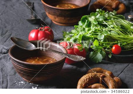 Carrot tomato pea soup 34586022