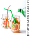 Grapefruit smoothie with marijuana leaves 34586244
