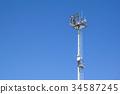 light pole tower on blue sky 34587245