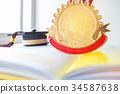 Golden medals and Graduation cap on book, graduate 34587638
