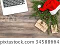 Office desk laptop Christmas decoration red hat  34588664