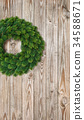 Christmas wreath decoration rustic wooden backgr 34588671