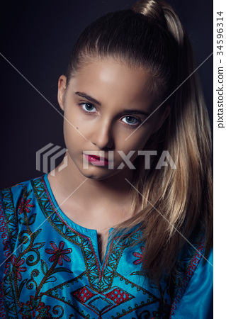 Closeup portrait of a fashion model posing at studio 34596314