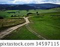 the crossroads of field roads in nature 34597115