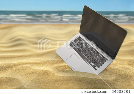 Computer laptop in the sand of the sea beach.  34608301