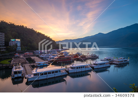 sunrise at sun moon lake in nantou, taiwan 34609378