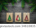Pine branch handmade gift boxes on wooden board 34610835