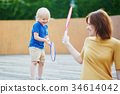 Little boy playing badminton with mom 34614042