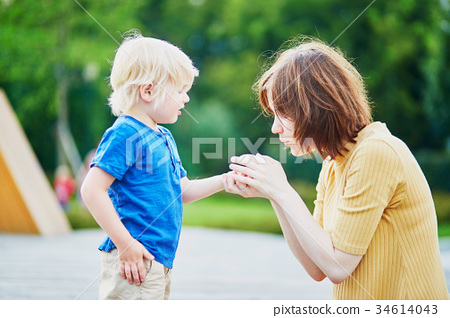 Mother comforting her son  34614043