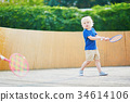Little boy playing badminton on the playground 34614106