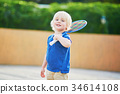 Little boy playing badminton on the playground 34614108