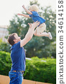 Father throwing his little son up in the air 34614158