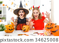 happy family in costumes   for halloween 34625008