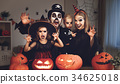 happy family  in costumes and makeup halloween 34625018