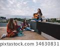 Beginning singer and fans 34630831