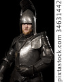 Knight in armour after battle on black background 34631442